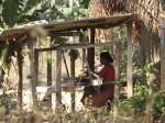 Woman working a hand loom